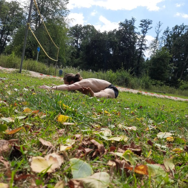 This image shows me training outdoors and performing a pancake stretch.