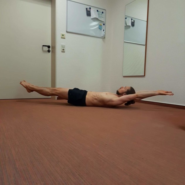 This is me performing a straight hollow body hold.