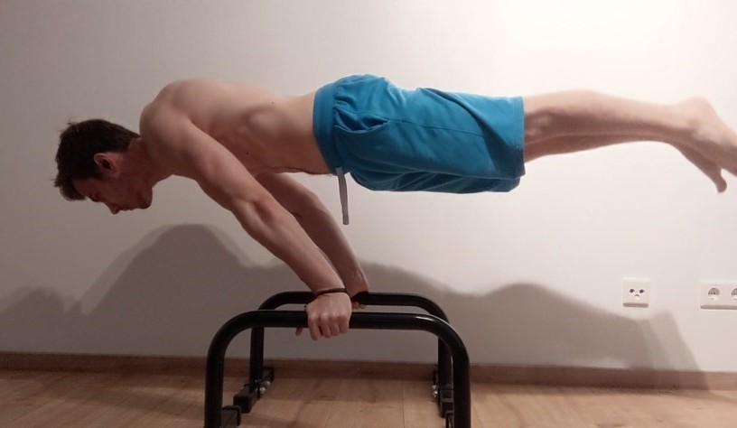 This Image shows Vladimiros from Workoutclarity performing a Full Planche.