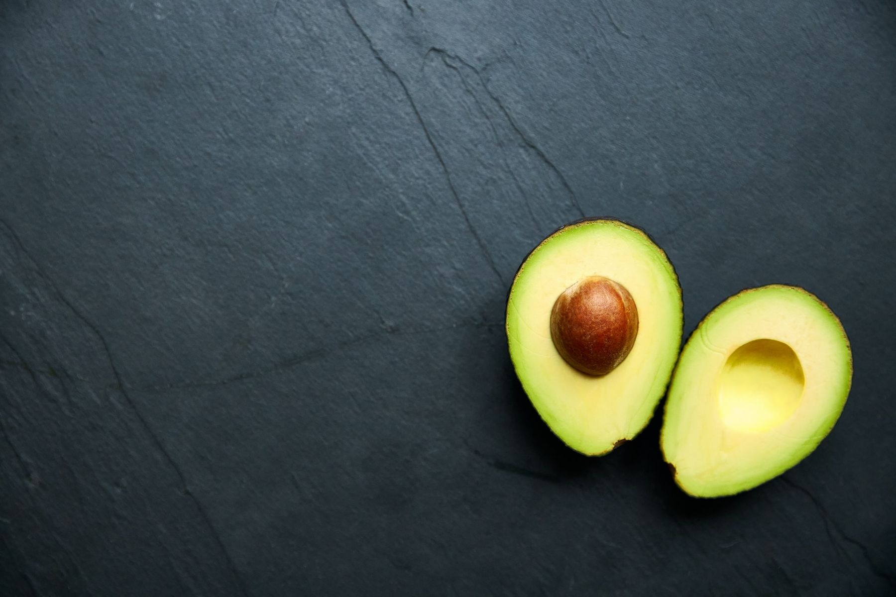 This image shows on avocado that contains healthy fats.