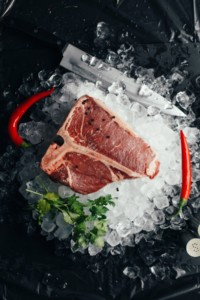 This image shows a T-bone steak on salt, a great source for protein to build lean muscles.