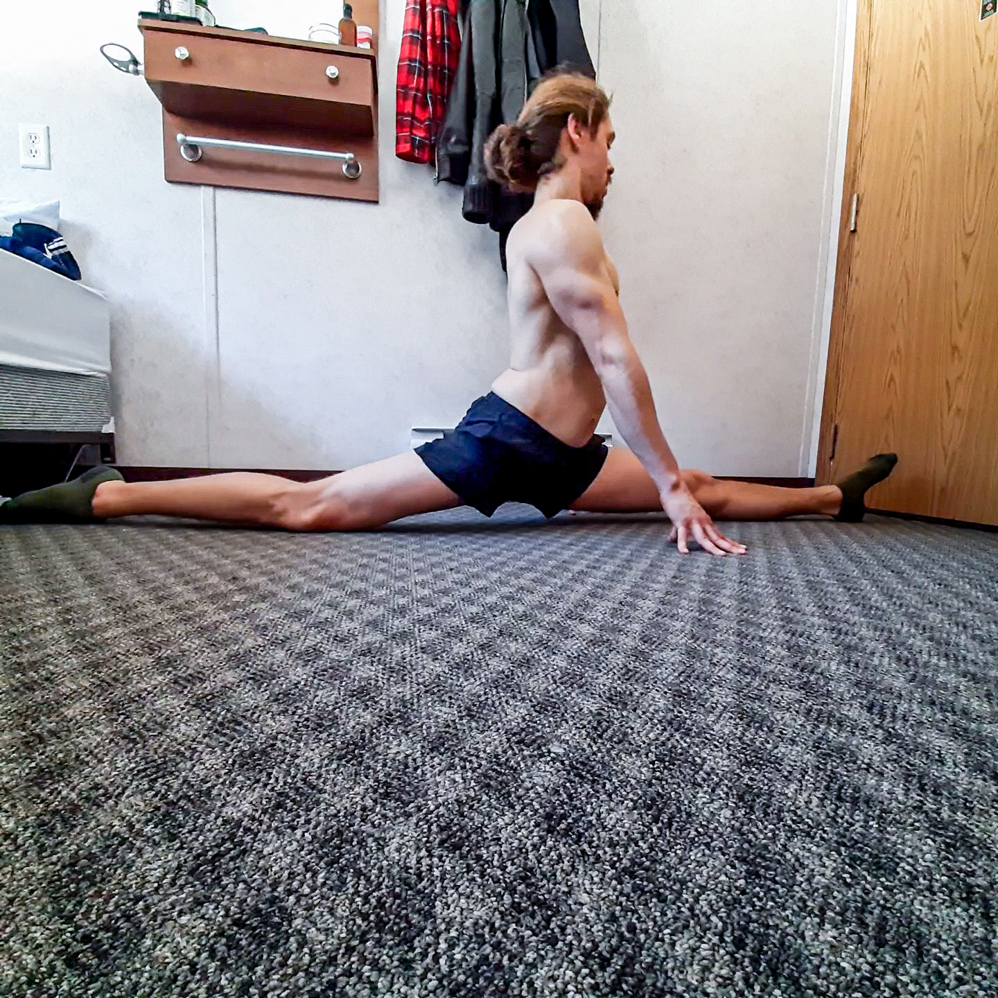 This image shows me performing front splits, one fundamental lower body flexibility position.