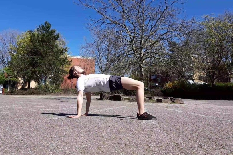 This image shows me performing a yoga table top pose.