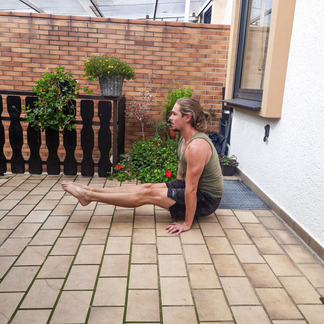 Me doing an l-sit on the floor - a splendid core and hip flexor exercise for compression strength.
